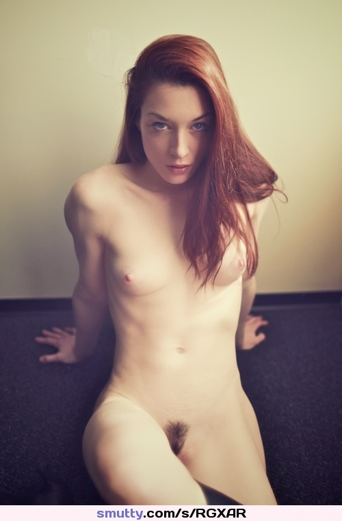 busty redhead fills her pink pussy with a gigantic dildo